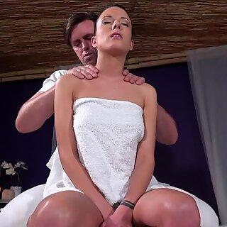 Brunette sucks masseurs big fat cock