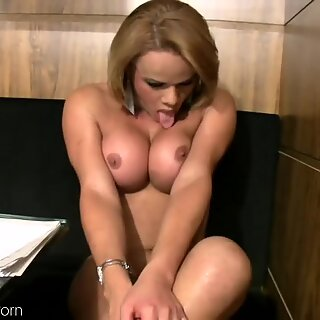 Busty shemale is showing massive ass and works on her cock