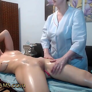 Lesbian Redhead gets Oiled and Massaged