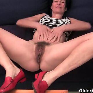 Granny in soaked panties fingering her hairy cunt