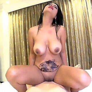 Big tit Asian MILF rides white cock