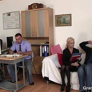 Skinny granny blonde takes two cocks